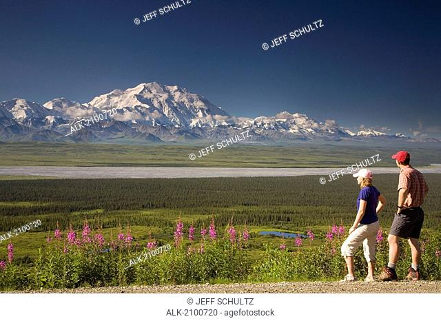 Young Couple View Mt Mckinley And The Alaska Range In Denali National Park Alaska Summer