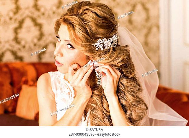 Young beautiful Bride preparing to wedding ceremony