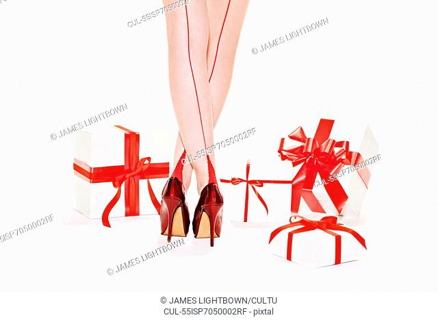 Woman wearing red stilettos with gift boxes