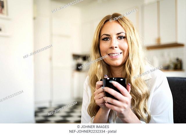 Portrait of woman having coffee