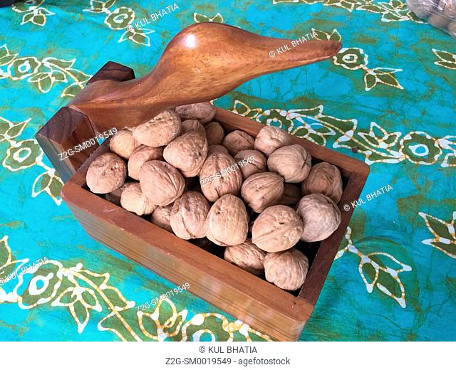 A nut cracker box full of walnuts, Ontario, Canada