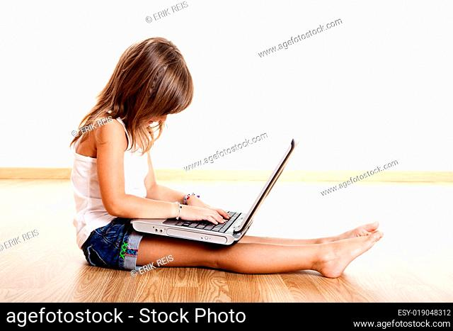 Child playing with a laptop