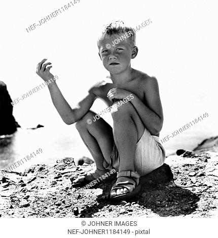Boy sitting on beach