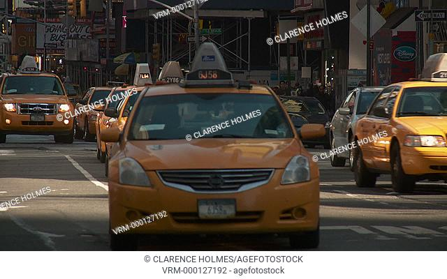 NEW YORK - MARCH 10: Taxis travel south on 7th Avenue through Times Square on March 10, 2013 in New York City