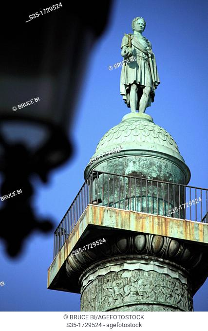 A closed up view of the statue of Napoleon I on top of the Vendome Column in the center of Place Vendome  Paris  France