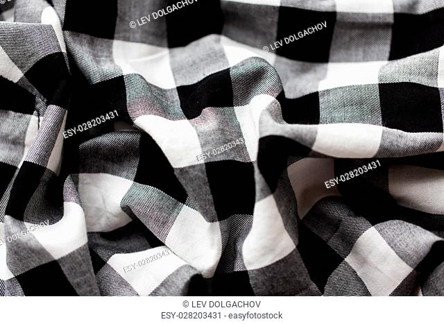 textile and clothes concept - close up of checkered fabric or clothing item