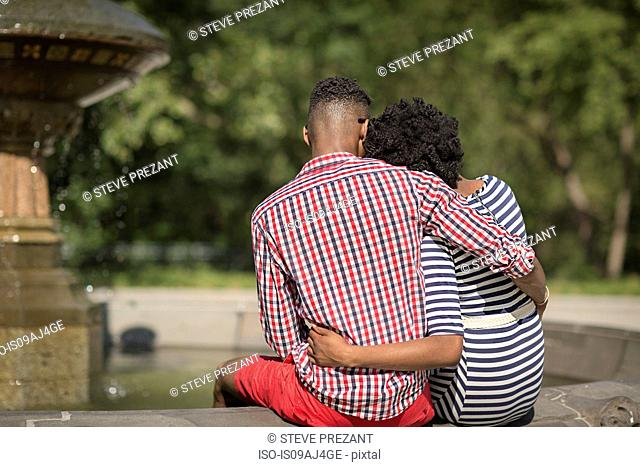 Rear view of young couple, Bethesda fountain, Central Park, New York City, USA