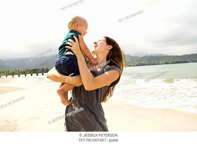 Young mother with baby daughter (6-11 months)