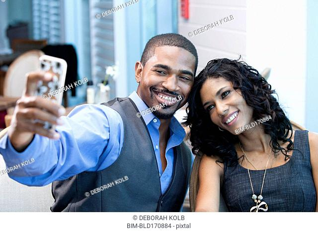 Business people taking selfie with cell phone in office