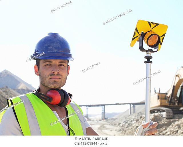 Worker standing in quarry