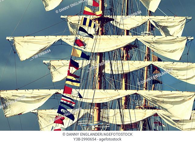View of sails and maritime signal flags from the Columbian Navy sailing ship, the ARC Gloria