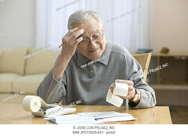 Stressed older man doing his taxes
