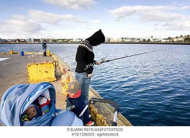 People fishing by the harbour, Hafnarfjordur, Iceland