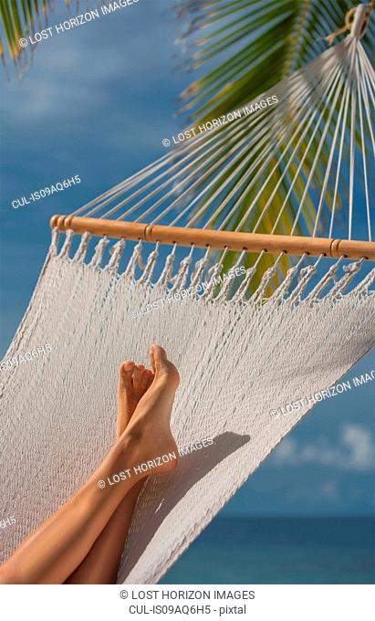 Woman's feet lying in hammock, Ari Atoll, Maldives