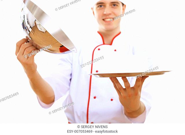Male cook in uniform holding an empty tray
