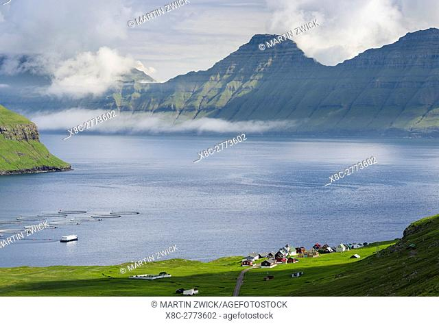 Hellur located at fjord Oyndarfjordur, in the background the mountains of the island Kalsoy. The island Eysturoy one of the two large islands of the Faroe...