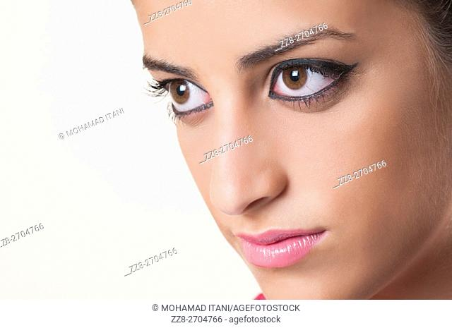 Close up of a beautiful young woman looking away