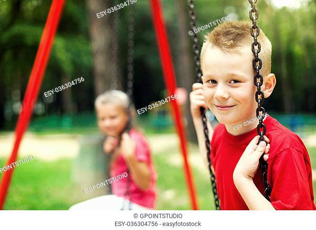 Children swinging together