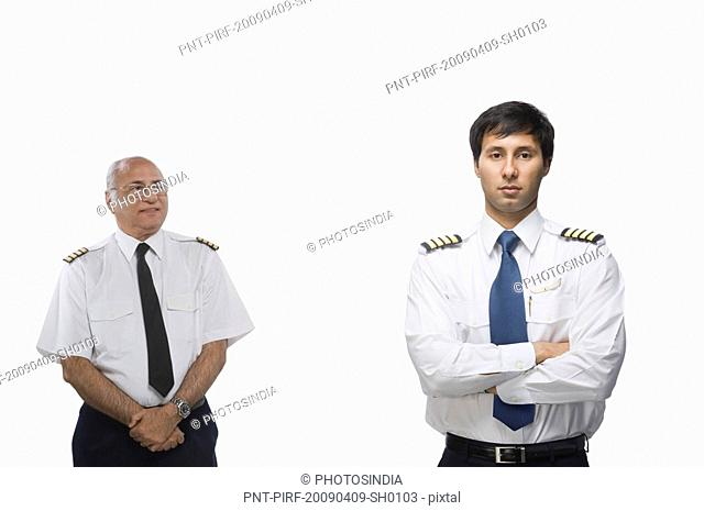 Two pilots showing different facial expression