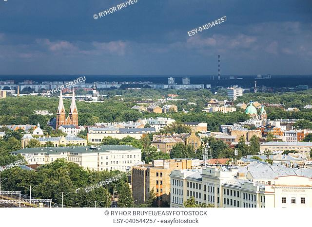 Riga, Latvia. Aerial Cityscape In Sunny Summer Day. Top View Of Landmarks - St. Francis Church, Ministry Of Transportation And All Saints Church