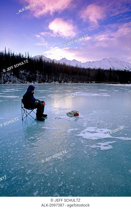 Man Ice Fishing On Long Lake Southcentral Alaska Winter/N