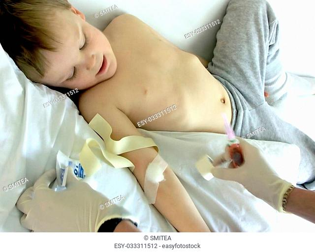 health care worker all done getting blood from a boy and boy is happy about it ,focus on arm ,health care hands moving