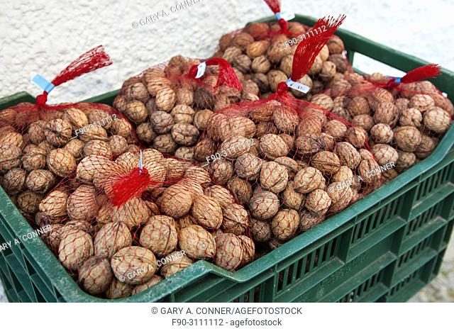 Bags of walnuts, nueces, for sale at mountain village of Pampaneira, Spain