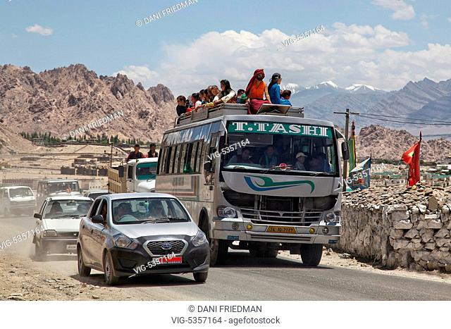 Ladakhi Buddhist devotees travel from the town of Choglamsar to the city of Leh after listening to His Holiness the 14th Dalai Lama perform prayers during the...