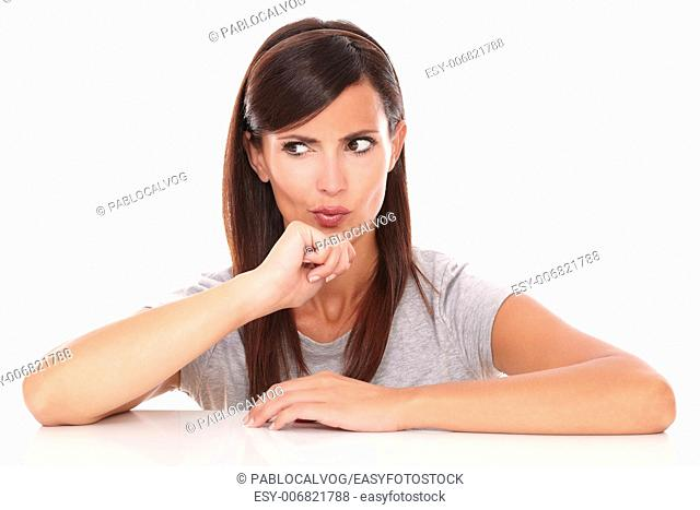 Portrait of pretty lady wondering while looking to her right on isolated white background - copyspace