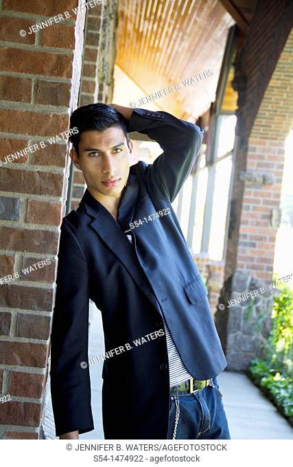 A young hispanic male outdoors near a shopping center in Spokane, Washington, USA
