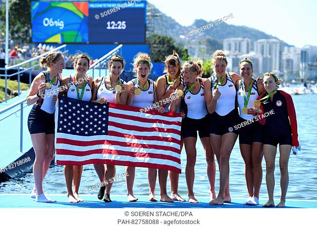 The team of the USA celebrates with the gold medals after winning the Women's Eight Final race of the Rowing events of the Rio 2016 Olympic Games at Lagoa...