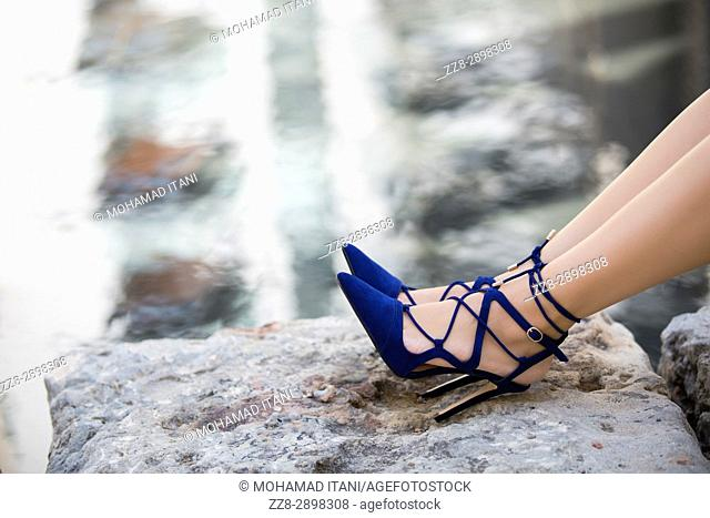 Close up of woman's feet in blue high heels