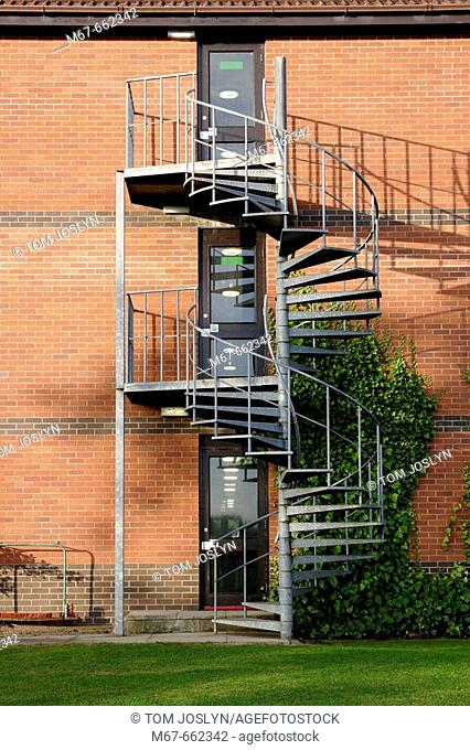 View of fire escape on three story building. England, UK