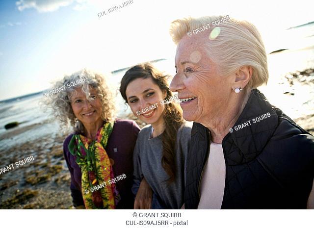 Female family members chatting on beach