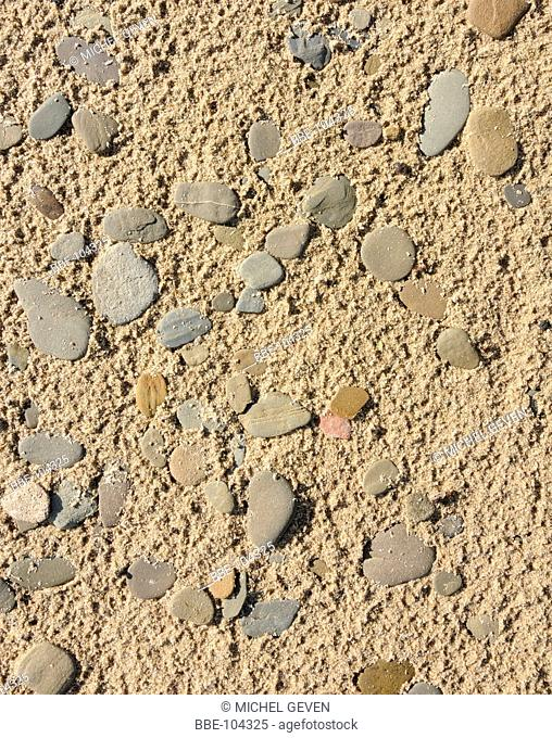 Flat gravelstones formed by the erosion of the riverwater and washed ashore on a rivershore