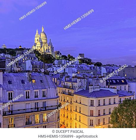France, Paris, the Sacre Coeur basilica and the rooftops of Montmartre hill at night