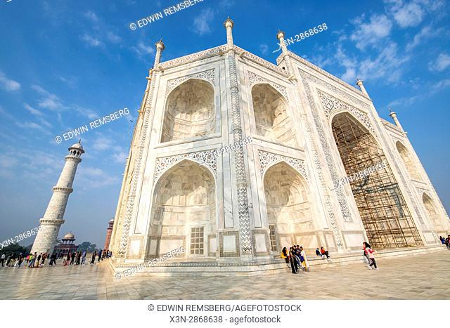 Tourists in line to enter the main tomb at the Taj Mahal, located in Agra, India