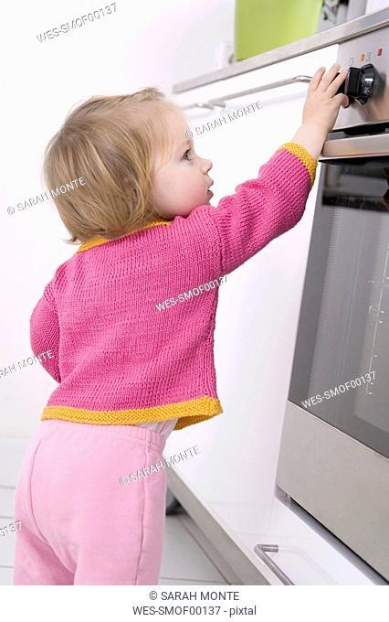 Baby girl 2-3 at stove