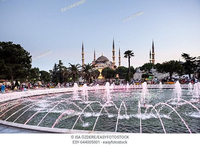 ISTANBUL,TURKEY-JUNE 11,2017:Night view of Sultanahmet Mosque with fountain in the foreground, Sultanahmet Park, Istanbul, Turkey