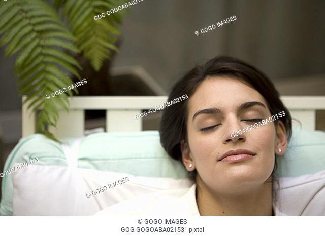 Woman sleeping in bathrobe