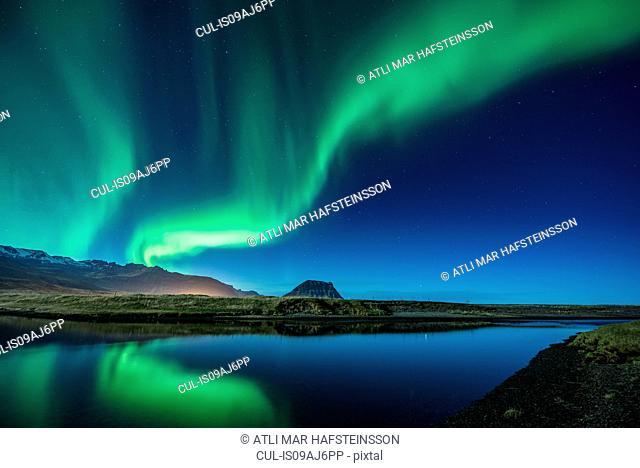 Aurora Borealis above Grundarfjordur, Mt. Kikjufell in centre, Snaefellsnes, Iceland