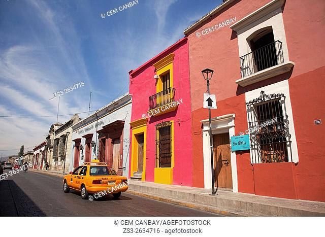 Cars in front of colonial buildings in the historic center, Oaxaca, Oaxaca State Mexico, Central America