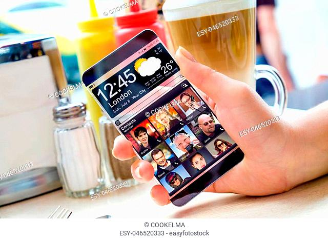 Futuristic Smart phone with a transparent display in human hands. Concept actual future innovative ideas and best technologies humanity