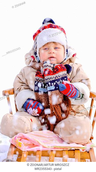 Beautiful baby boy on sledge