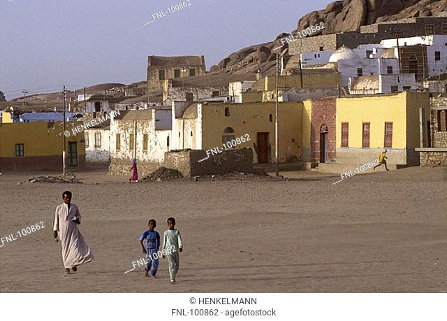 Native person with two children in village, Aswan, Egypt