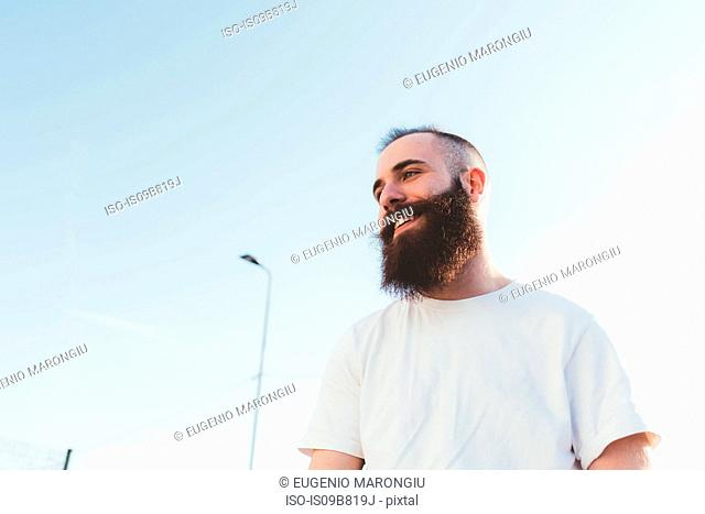Portrait of bearded man looking away smiling