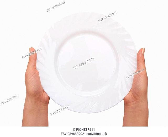 white kitchen plate on woman hand on white background