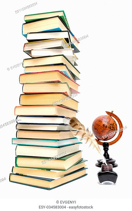 school supplies. pen in the ink, a large stack of books and a globe on a white background