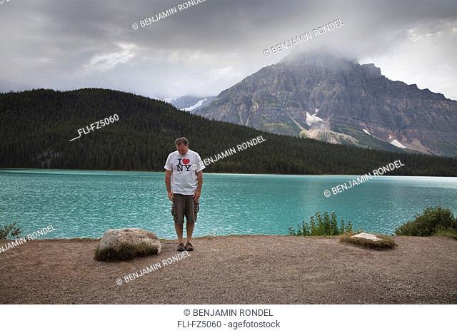 Tourist standing next to lake, Banff National Park, Alberta