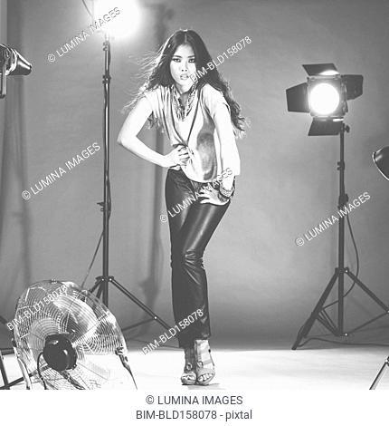Glamorous woman posing in photo shoot